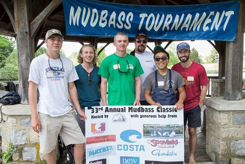 Members of the Virginia Tech Student Chapter of the American Fisheries Society holding banner for the 33rd Annual Mudbass Classic